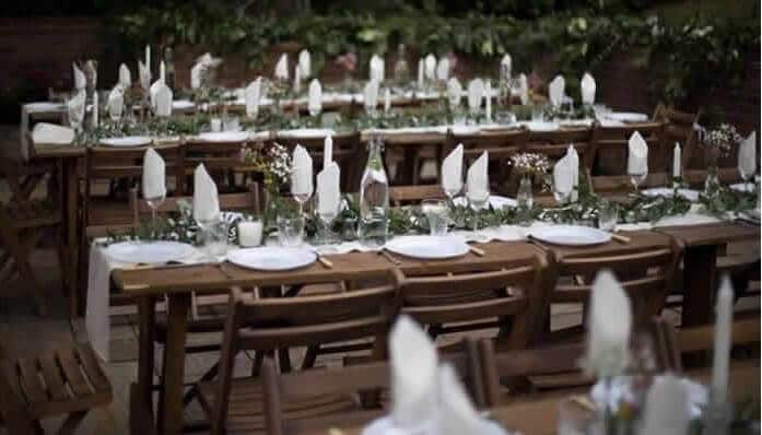 rustic tables and chairs for a wedding / party